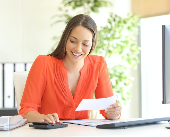 Actuarial professional working at her desk