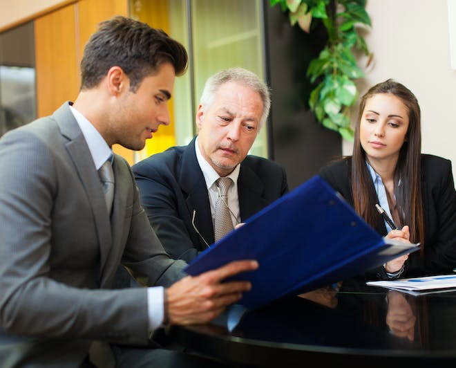 Lawyer discussing with clients. Study an LL.M. degree abroad to advance your law career.