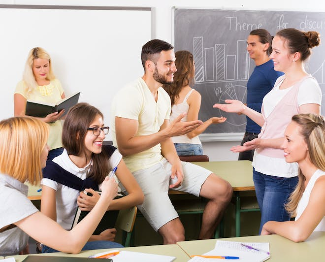 Students communicating in the classroom during break