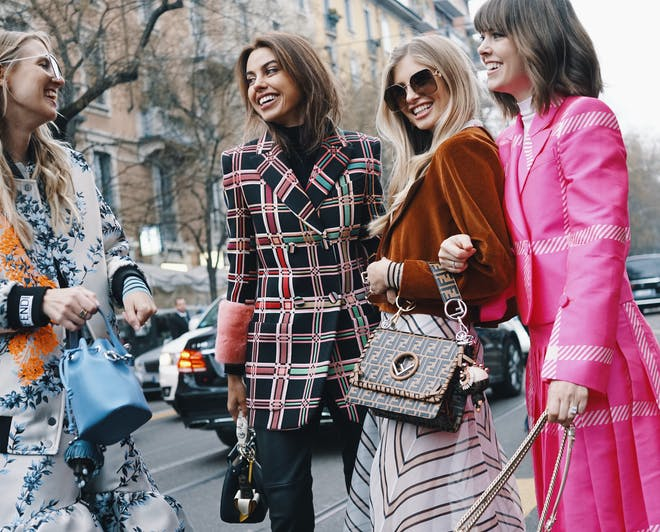 Girls wearing fashionable clothes during the Milan Fashion Week