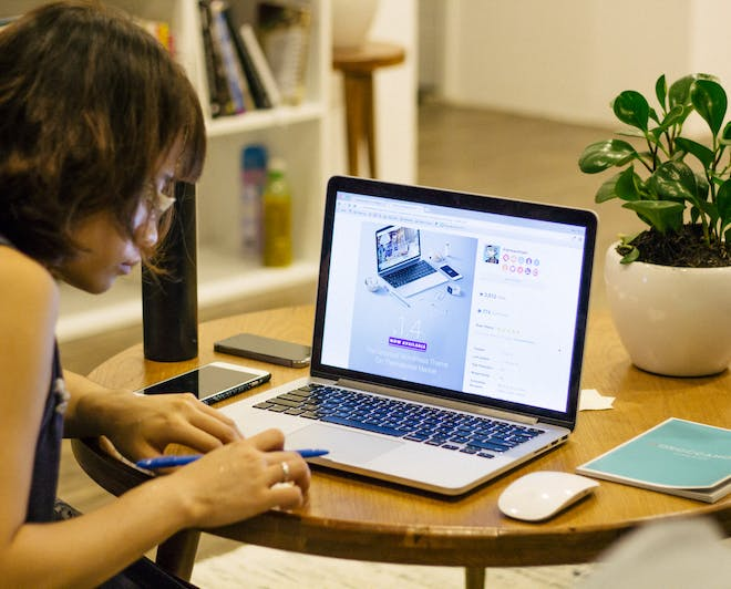 Student working on her laptop at home