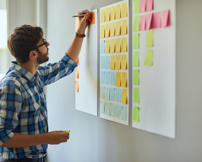 Student using sticky notes to organise his ideas