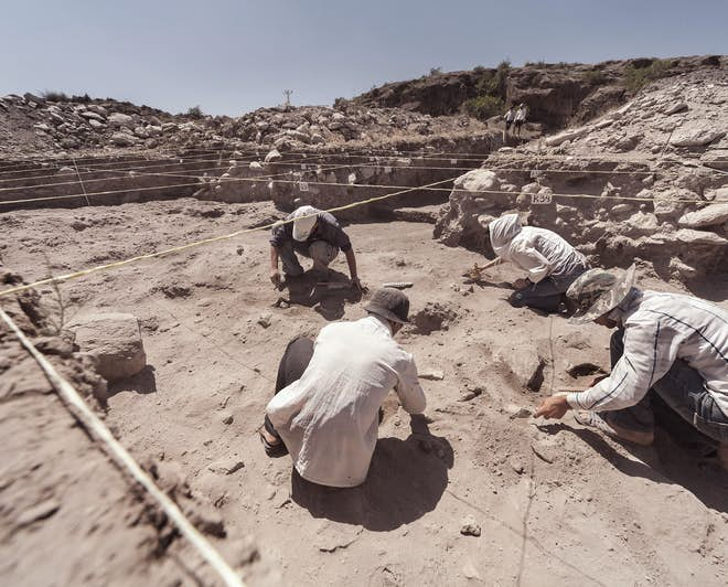 Archaeologists working on a site