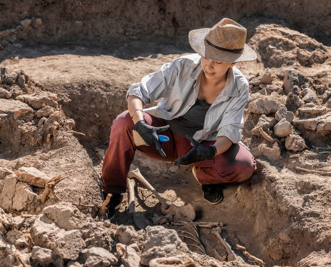 Archaeologist working on site