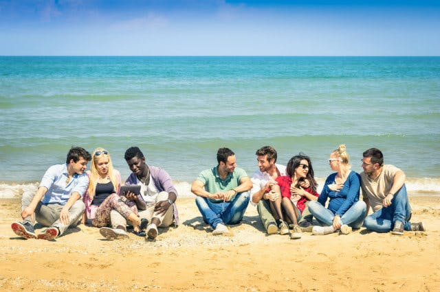 University students relaxing on Australian beach