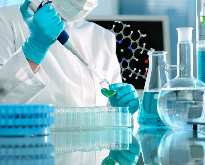 Researcher working with substances in a laboratory