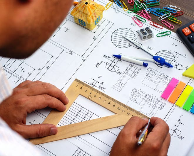 Mechanical Engineering student working on a project