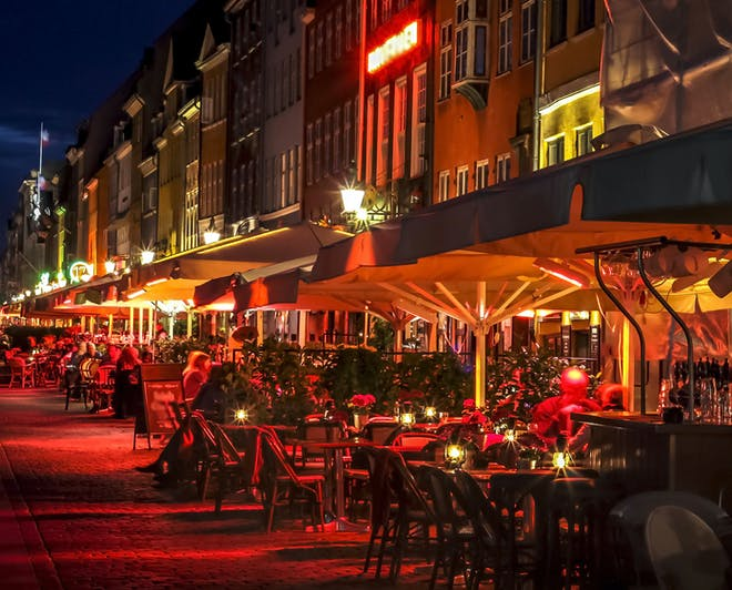 Street in Denmark with restaurants and terraces